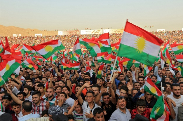 Kurdish people attend a rally to show their support for the upcoming September 25th independence referendum in Duhuk