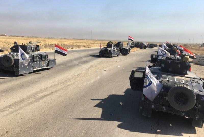 Members of Iraqi federal forces enter oil fields in Kirkuk, Iraq