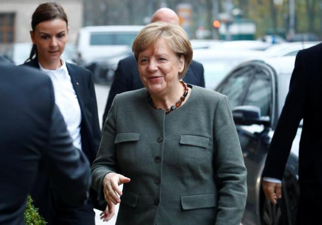 Angela Merkel, leader of the Christian Democratic Union (CDU), arrives at the German Parliamentary Society offices before the start of exploratory talks about forming a new coalition government in Berlin, Germany November 10, 2017