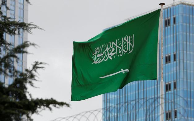 A Saudi flag flutters atop Saudi Arabia's consulate in Istanbul