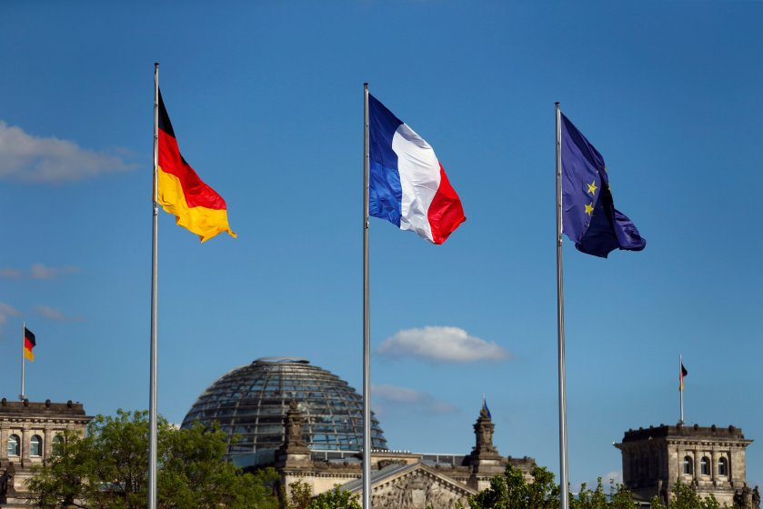 The flags of Germany, France and the European Union are seen in front of the the Chancellery, before the meeting between German Chancellor Angela Merkel and French President Emmanuel Macron in Berlin